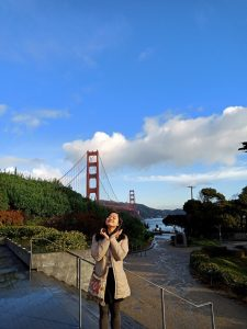 Huong poses with the Golden Gate Bridge in the background