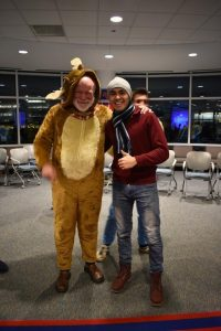 Firdavs is standing next to his advisor, Pat, who is wearing an animal Halloween costume.